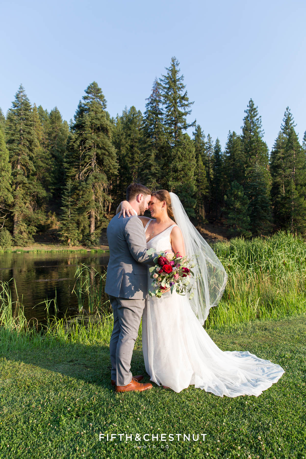 portrait of bride and groom snuggling close after their Greenhorn Creek Guest Ranch Wedding ceremony