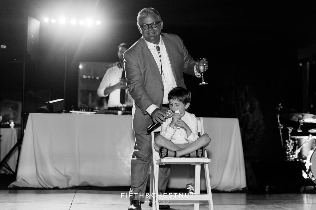 best man gives a speech with the help of his son at a Greenhorn Creek Guest Ranch Wedding