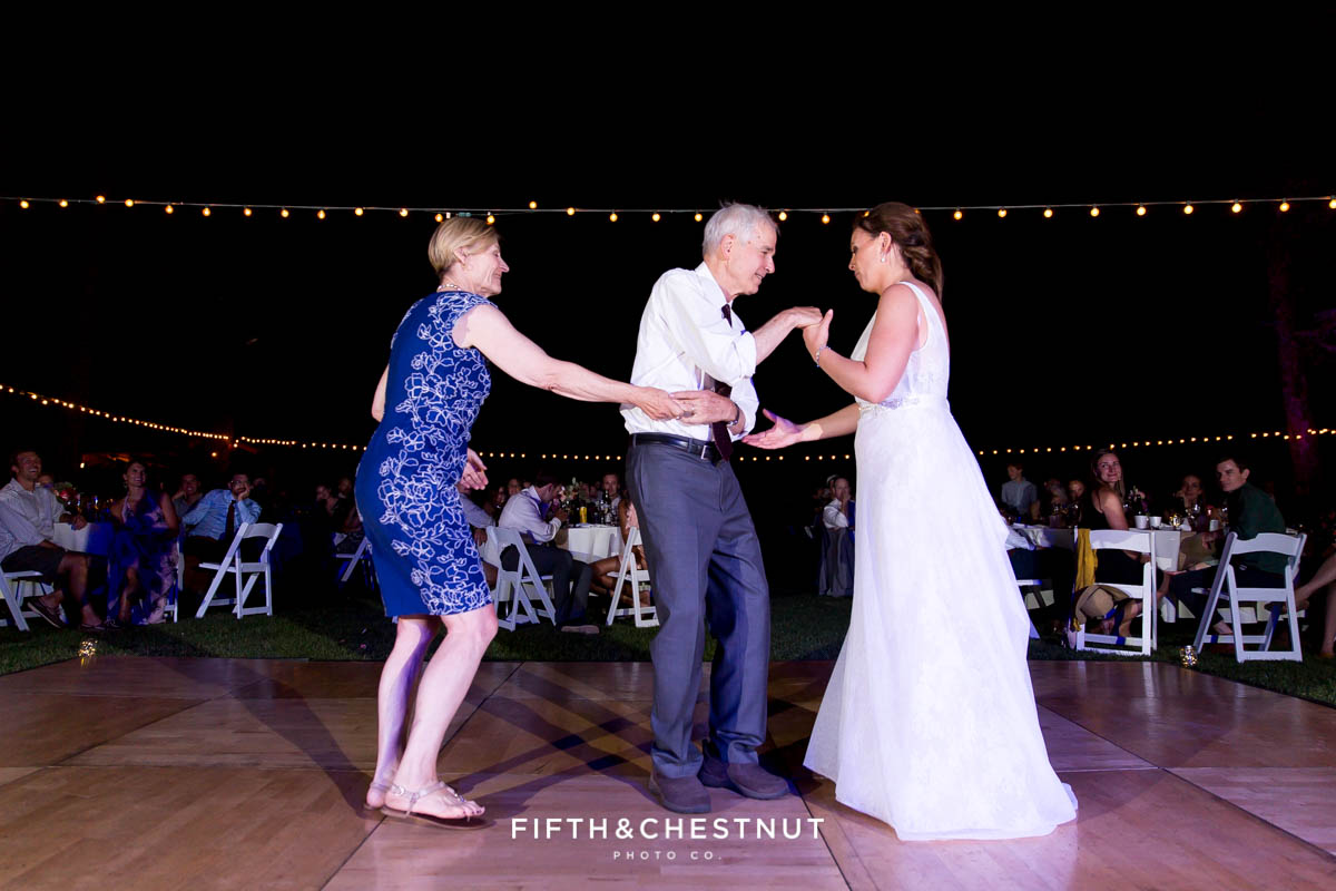 bride dances with her father and mother during a Greenhorn Creek Guest Ranch Wedding