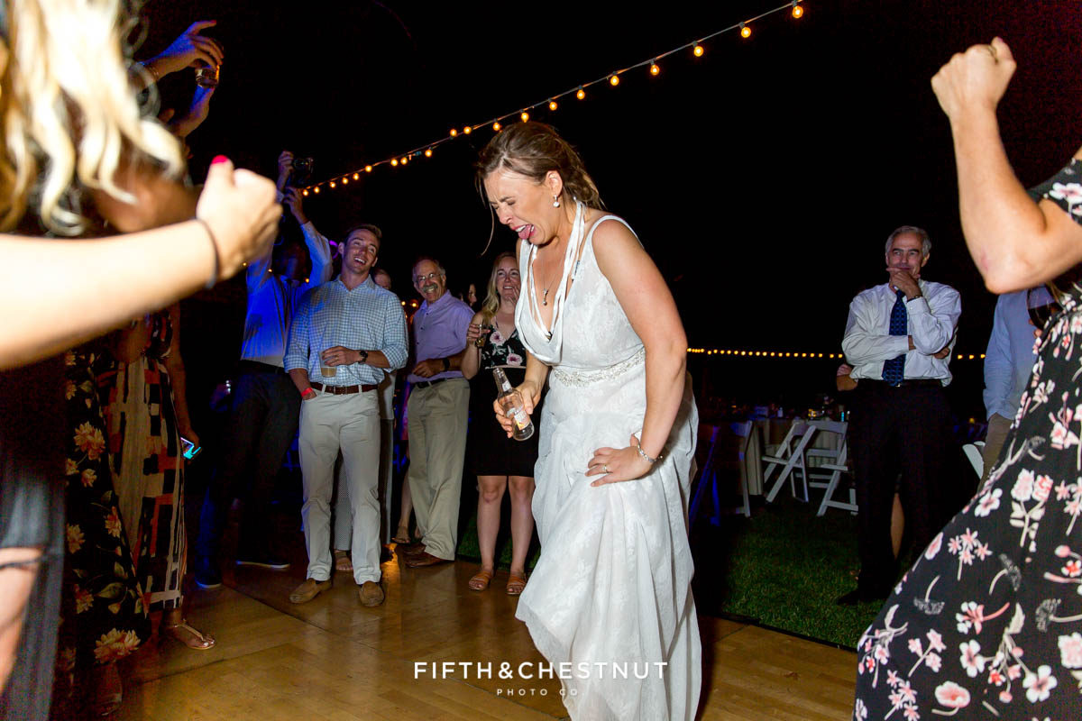 bride makes sour face after chugging a whole smirnoff ice in less than a minute at her Greenhorn Creek Guest Ranch Wedding