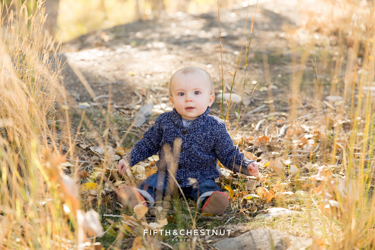 baby boy playing with sticks for his Mayberry Park Portraits