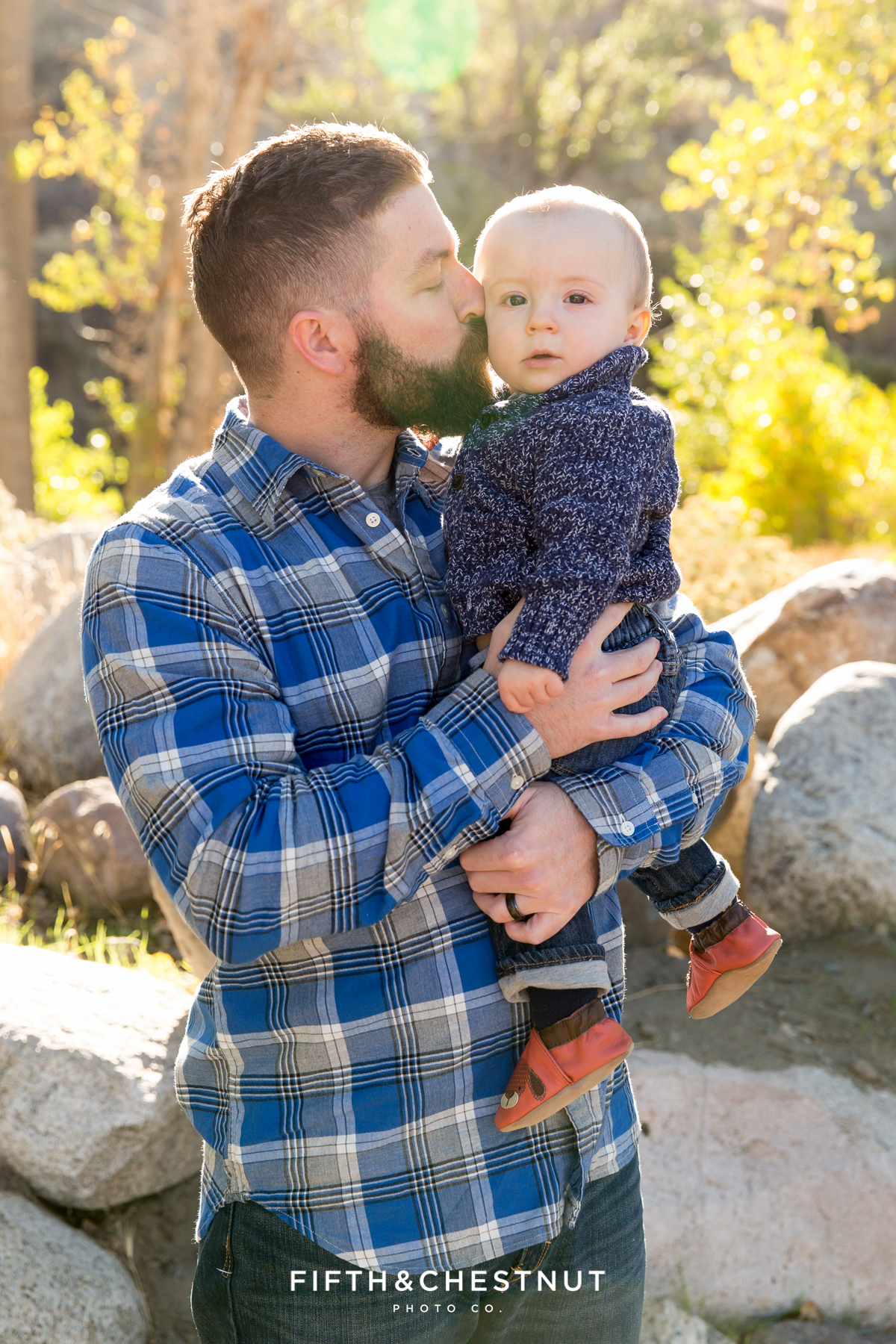 Father kisse his son's cheek for Mayberry Park Portraits