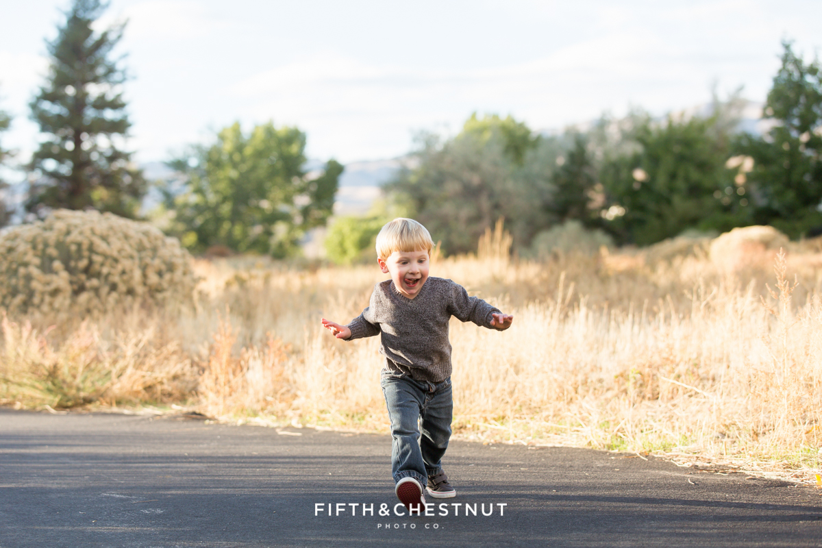 Mayberry Park Portraits portray a toddler running with his arms stretched out wide