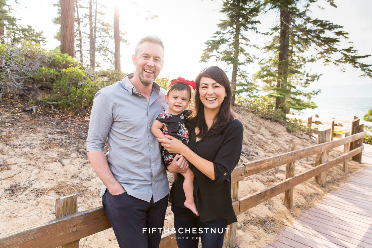 Family portrait of mom, dad and one year old girl in lake tahoe by Reno Family Photographer