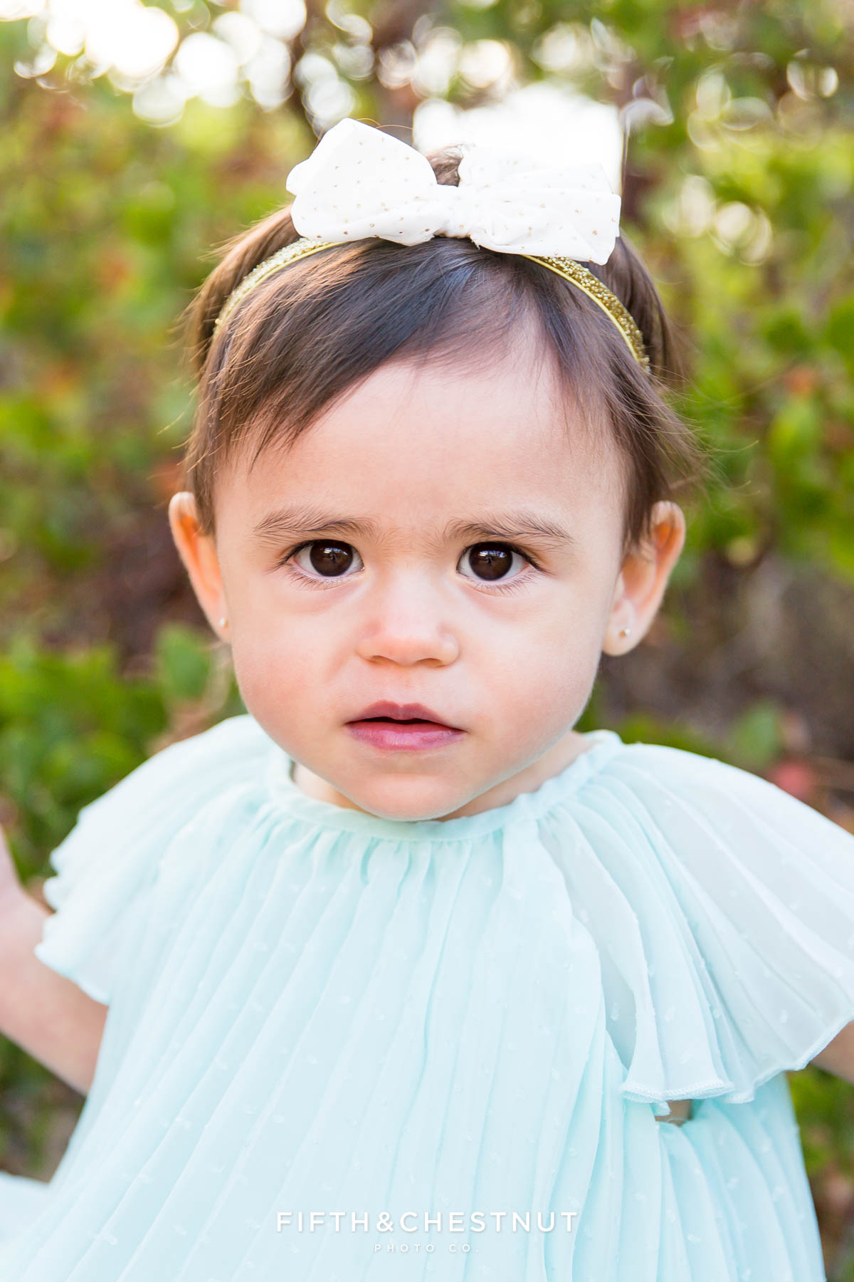 closeup of one year old girl for her fashionable one year portraits by Reno child photographer