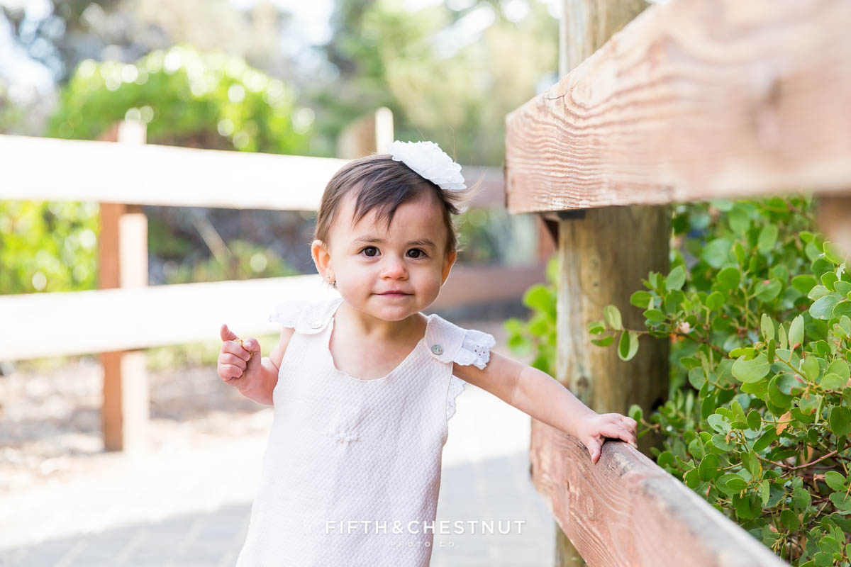 fashionable one year portraits by Reno child photographer of one year old girl in Lake Tahoe