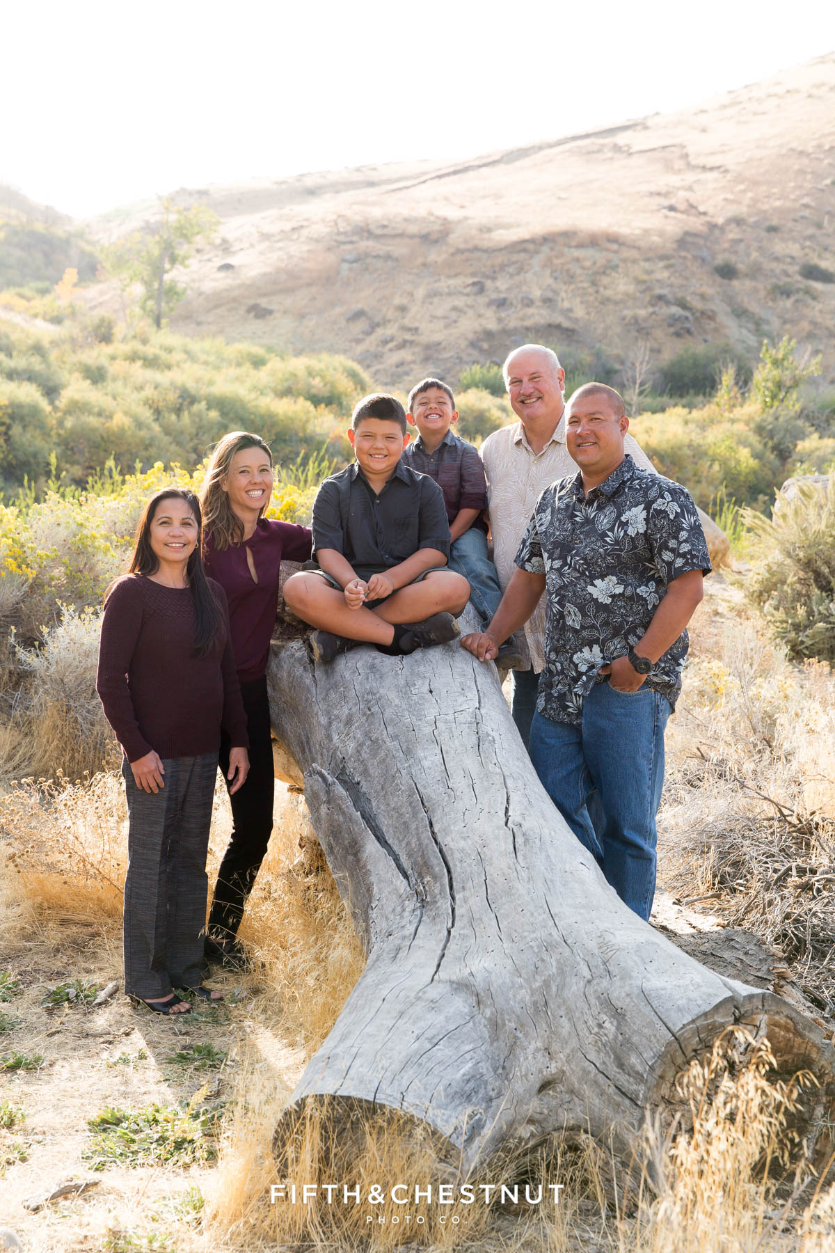 vibrant fall portraits at Mayberry Park of family on a log