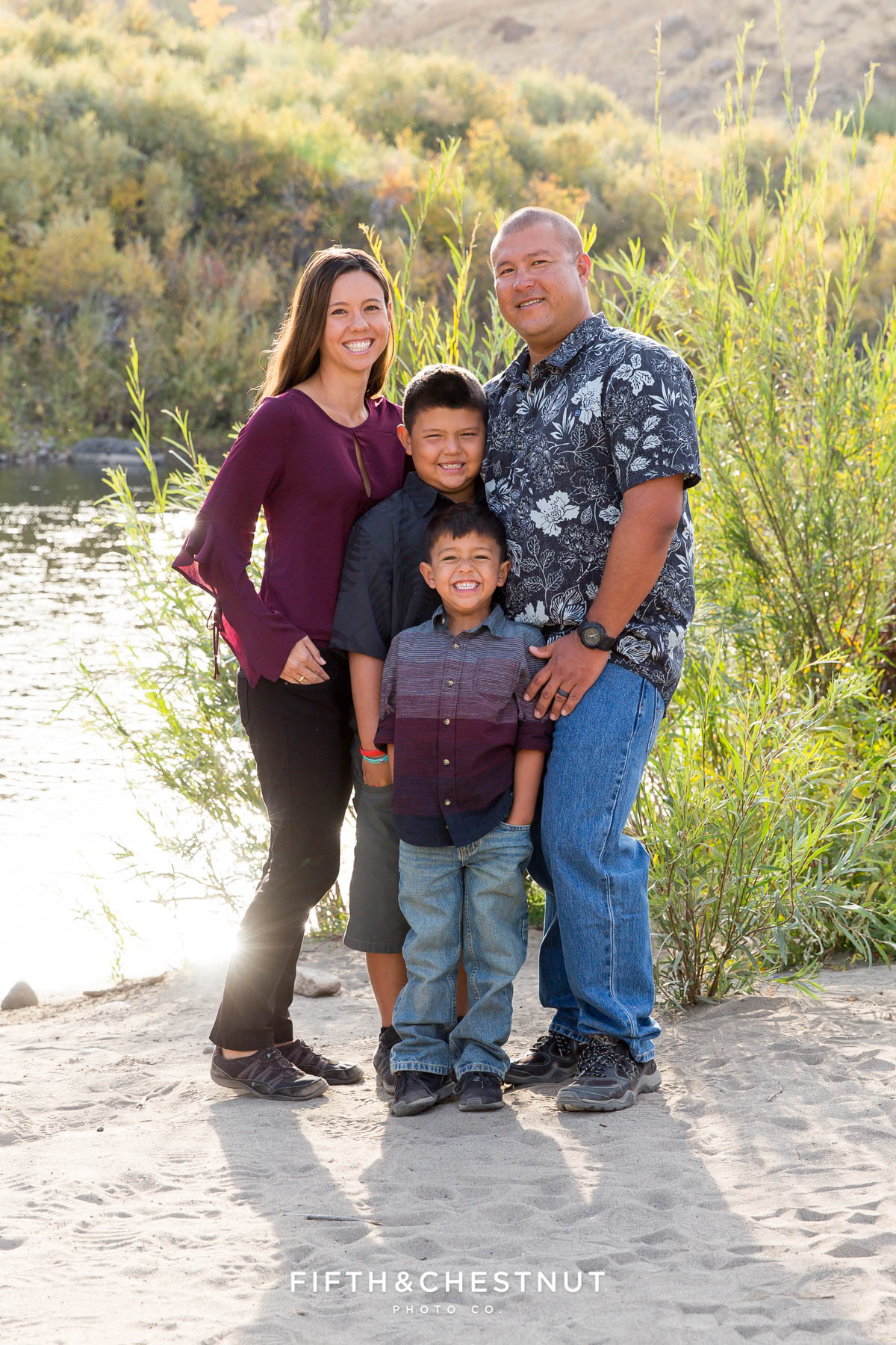 vibrant fall  portraits at Mayberry Park in front of truckee river