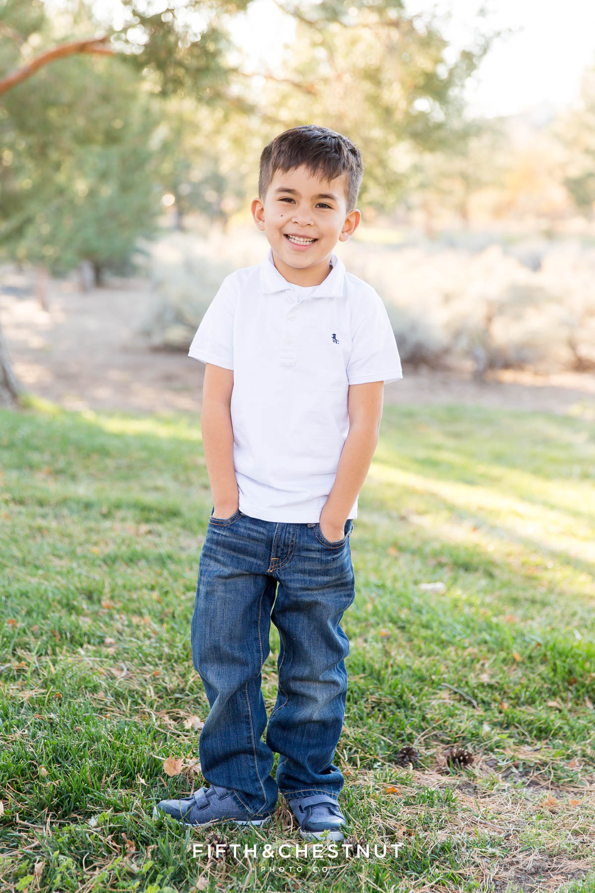Portrait of 6 year old boy in white shirt for his Caughlin Ranch Family Portraits