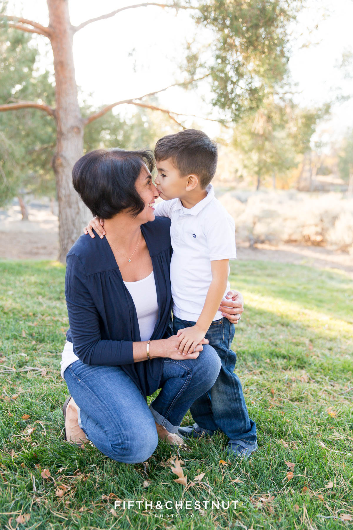 Son kisses his mom's nose for Caughlin Ranch Family Portraits