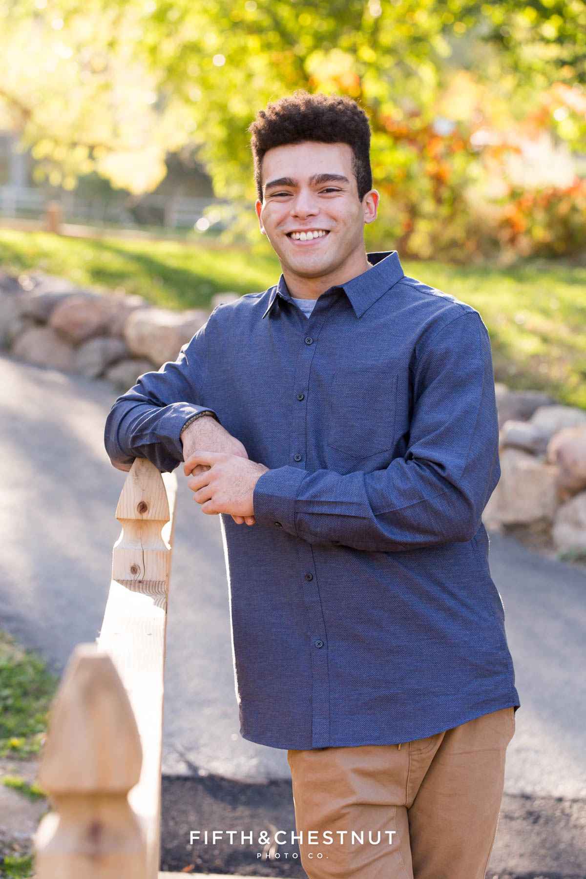 19 year old son poses for his fall family portraits at Caughlin Ranch by Reno Family Photographer