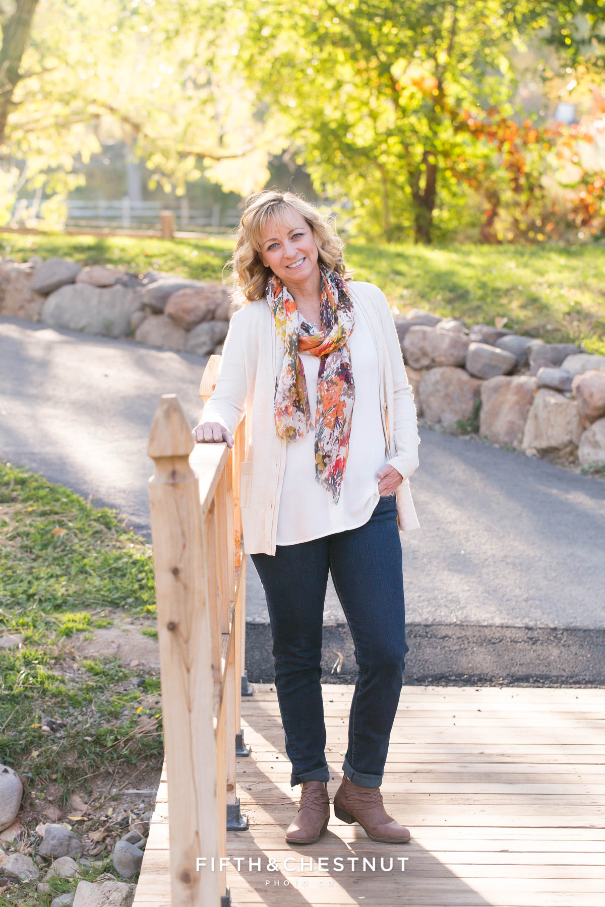 Mom poses for her fall family portraits at Caughlin Ranch
