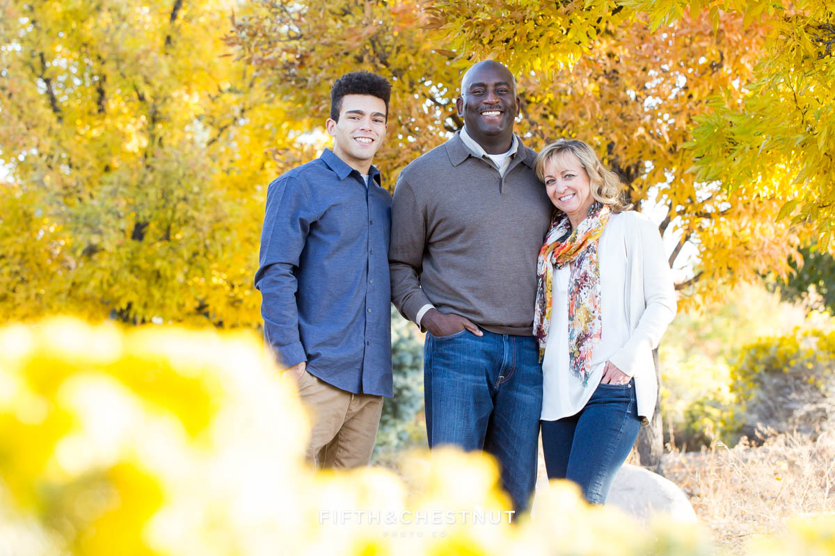 Family of three surrounded by fall foliage for Reno fall family portraits