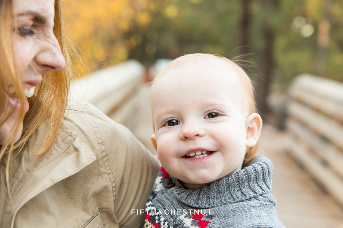 Smiling happy one year old at galena creek park in reno
