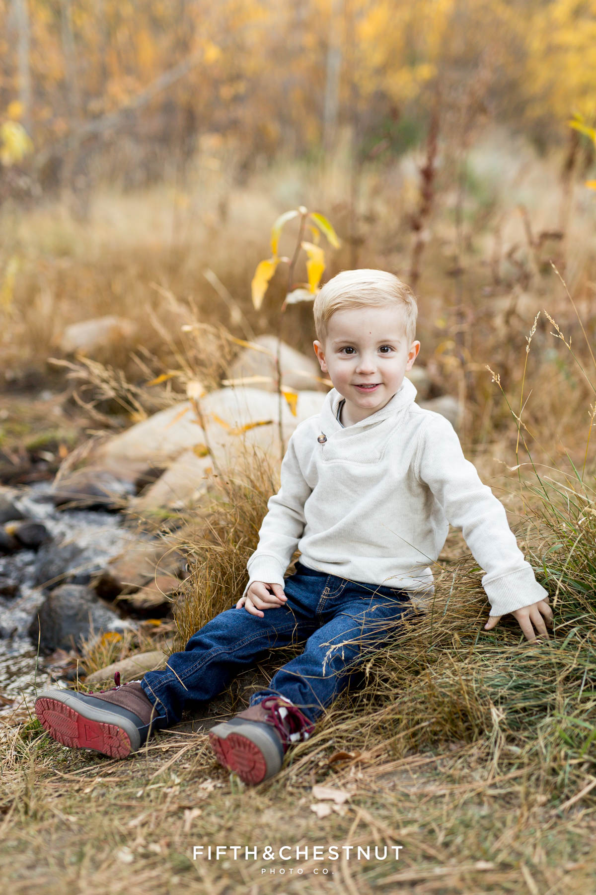 Portrait of 2 year old boy during his Fall Galena Creek Portraits by Reno Family Photographer