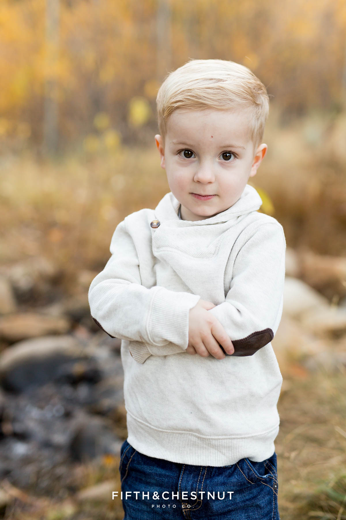 toddler with serious expression poses for his Fall Galena Creek Portraits