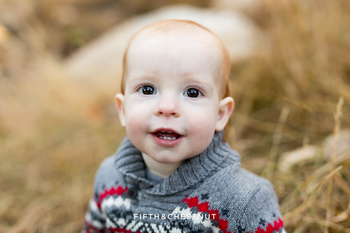 baby looking towards camera with curious expression during his reno family photos at galena creek park