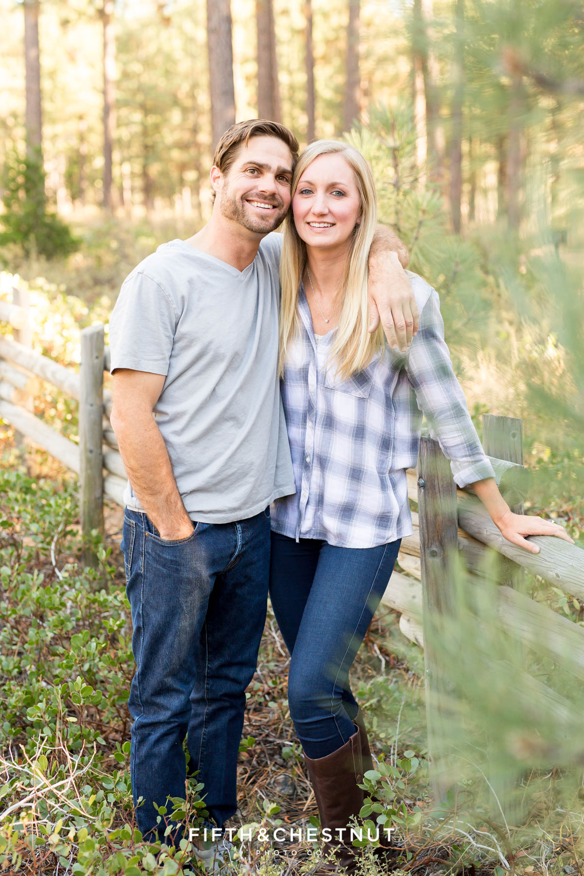 Engaged couple smiles for Lake Tahoe Wedding Photographer during their fall Nevada Beach engagement