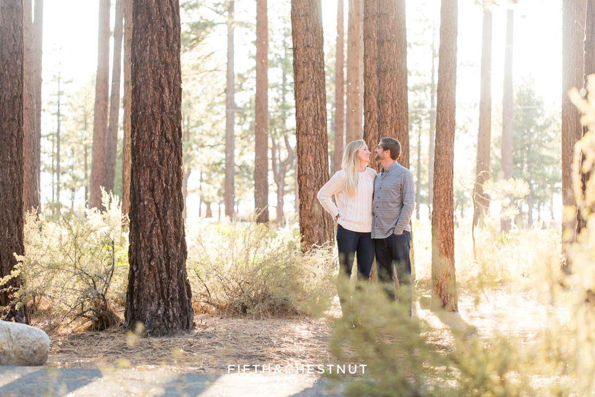 Engaged couple interact with each other at their fall Nevada Beach engagement