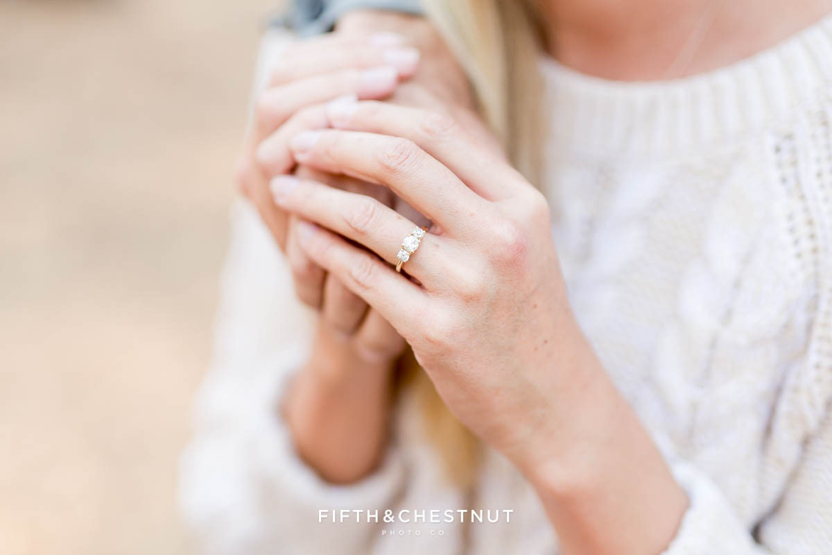 Closeup of engagement ring at fall Nevada Beach engagement session