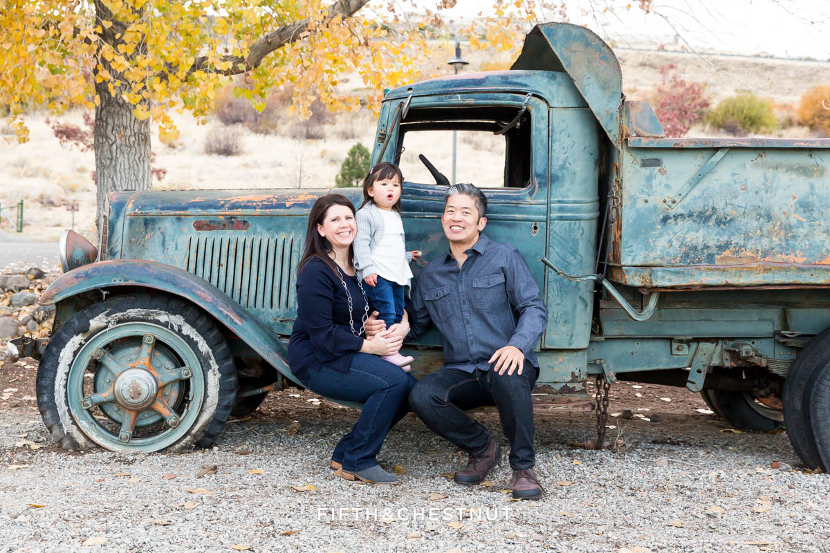 Family sitting on old blue truck at Bartley Ranch for their Adorable Reno Family Portraits by Reno Family Photographer