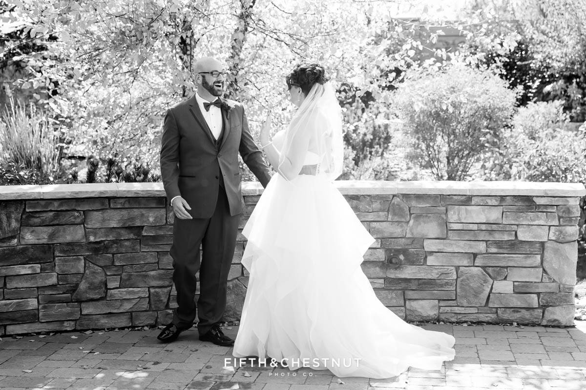groom turns to see his bride during a first look at a Bright fall wedding at the Grove by Reno Wedding Photographer