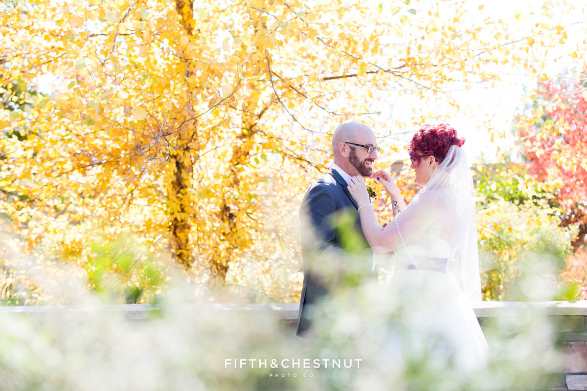 bride and groom examine each other after their first look for their Bright fall wedding at the Grove by Reno Wedding Photographer