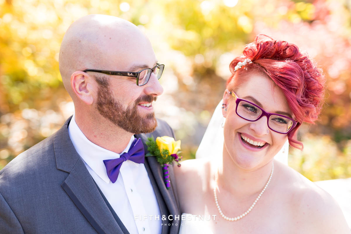 bride and groom laugh together at a Bright fall wedding at the Grove by Reno Wedding Photographer