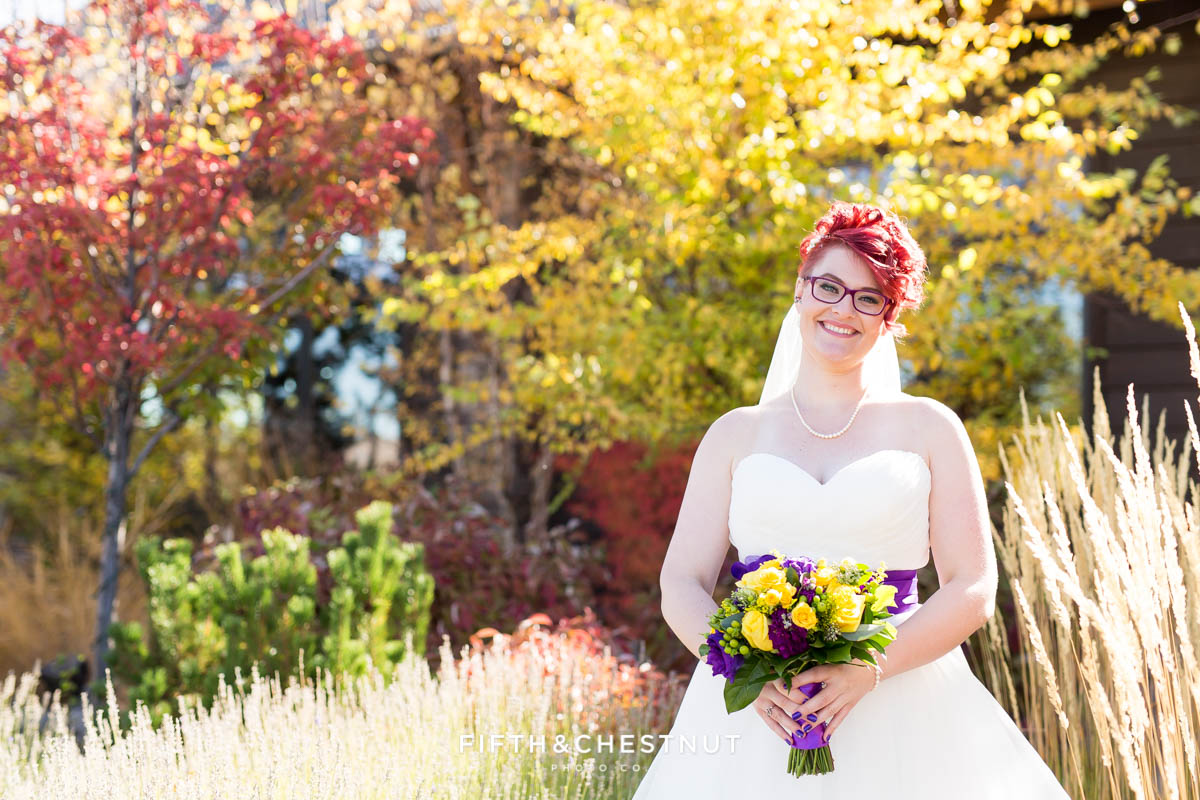 portrait of bride with her bouquet for her Bright fall wedding at the Grove by Reno Wedding Photographer