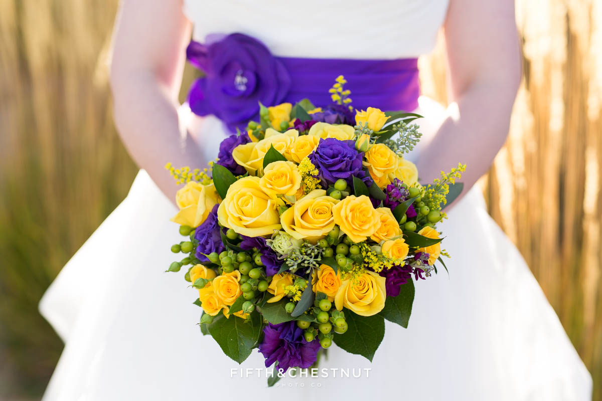 Bright and bold purple and yellow wedding bouquet for a Bright fall wedding at the Grove by Reno Wedding Photographer