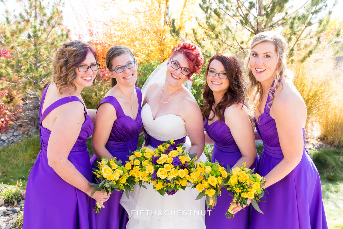 bridal party shows off their bouquets at a Bright fall wedding at the Grove by Reno Wedding Photographer