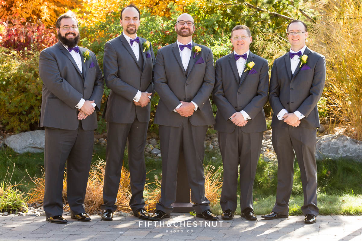groom and groomsmen standing together before a Bright fall wedding at the Grove by Reno Wedding Photographer