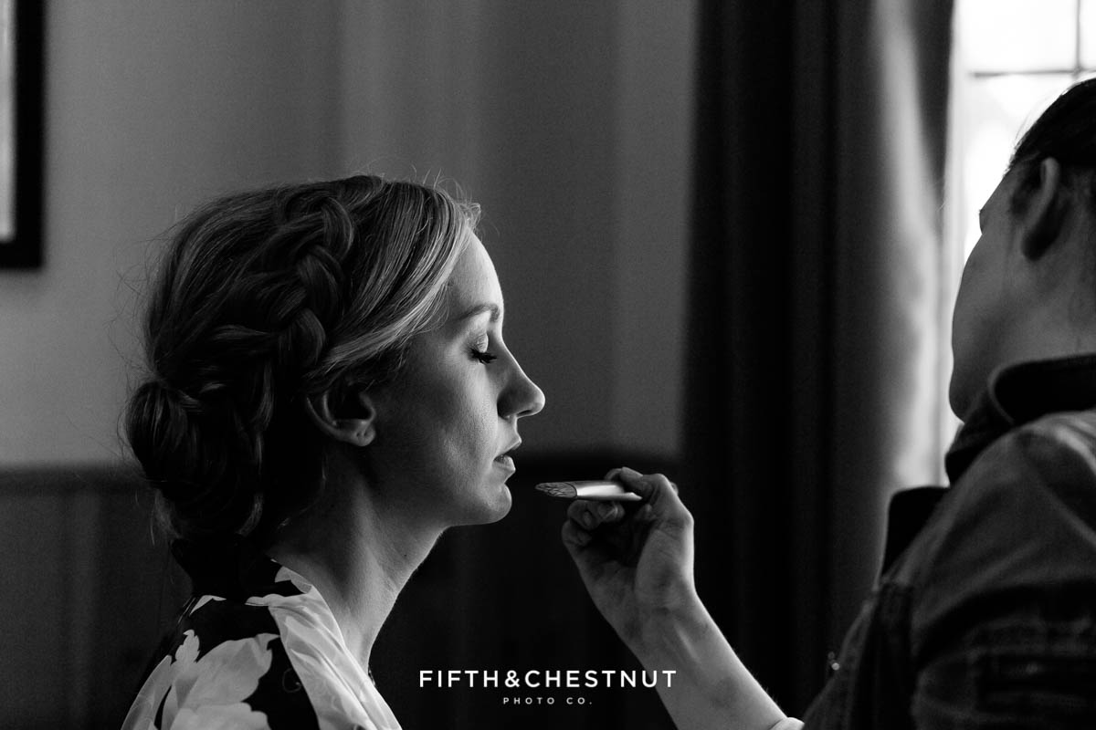 Greco Rose Beauty applying makeup to a zephyr cove bride
