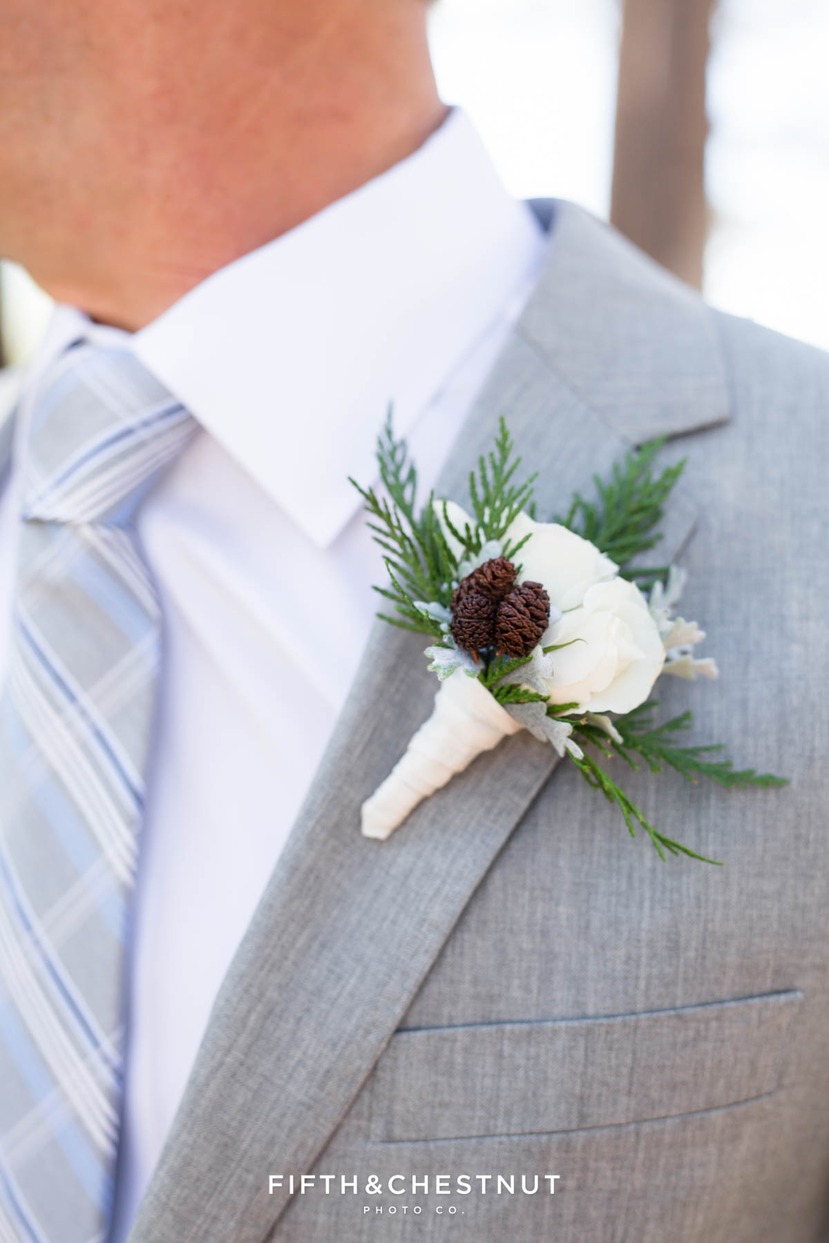 boutonniere by twine and dandy on a groom's lapel