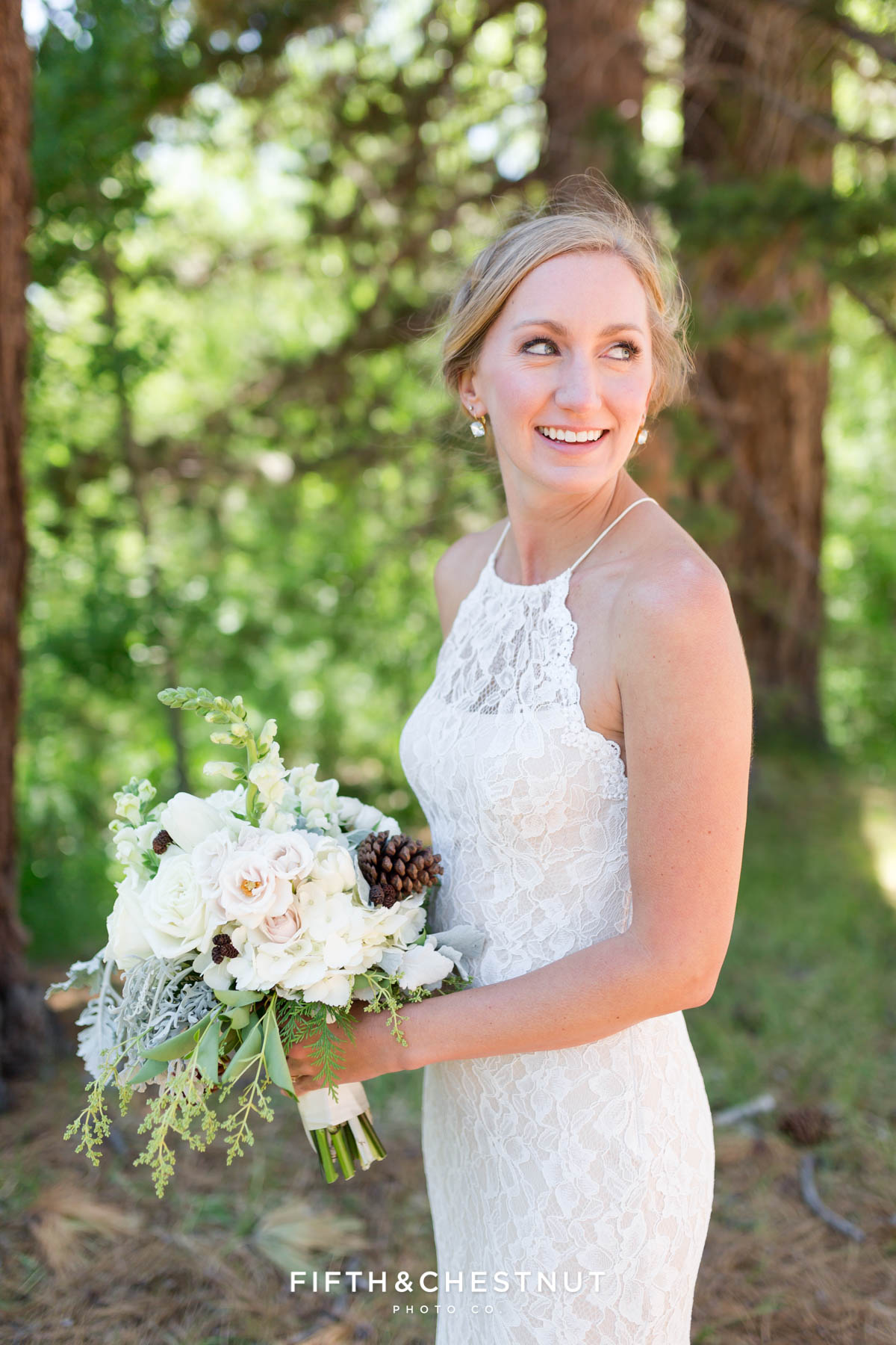 bride looks over her shoulder for a portrait before her zephyr cove wedding in Lake Tahoe