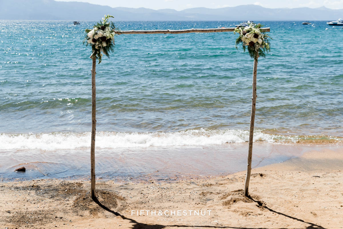 wedding arch florals for a tahoe wedding with lake tahoe in background