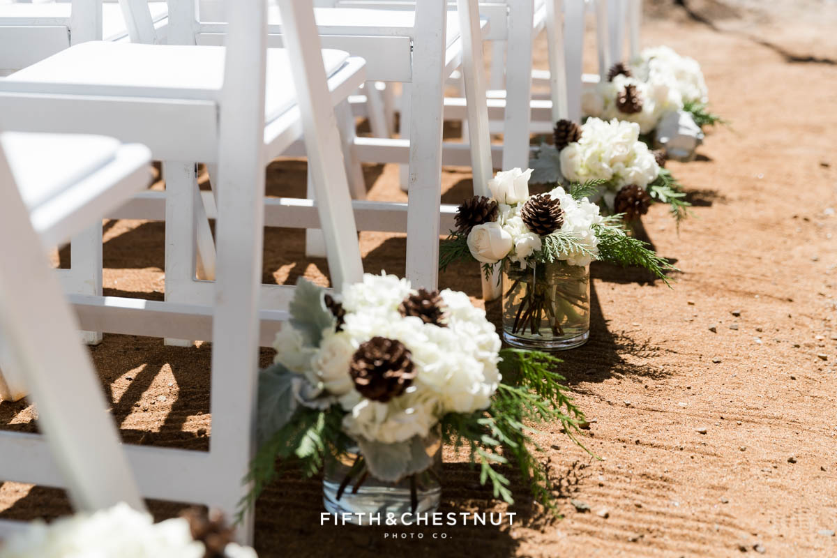 wedding aisle lined with flowers by twine and dandy for a lake tahoe summer wedding