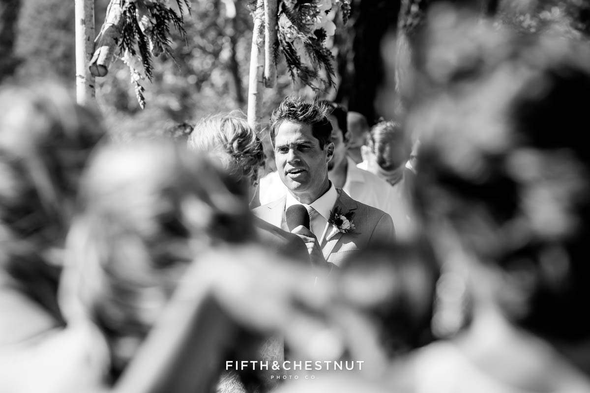 groom reads his vows at a lake tahoe wedding