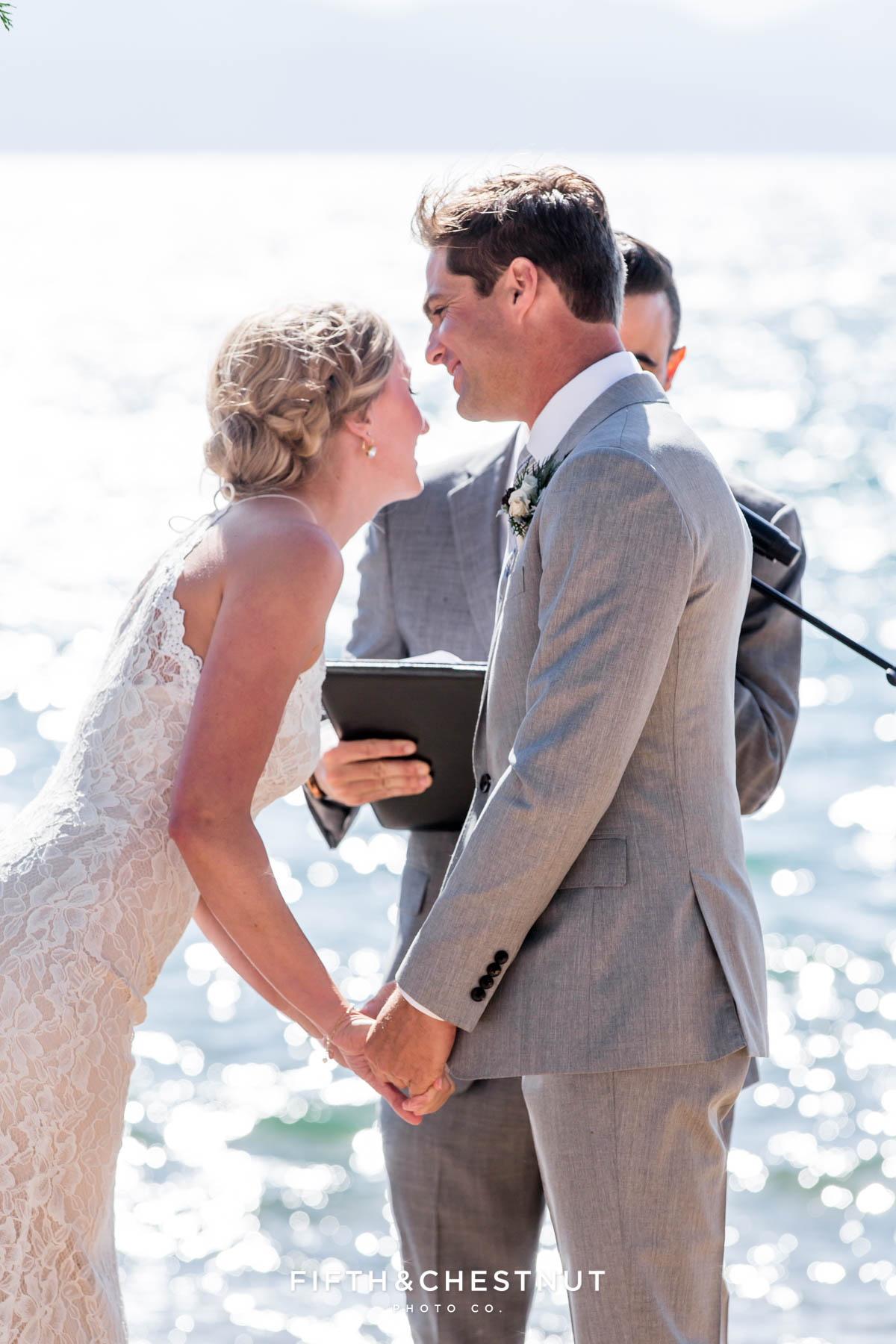 bride laughs during lake tahoe wedding ceremony