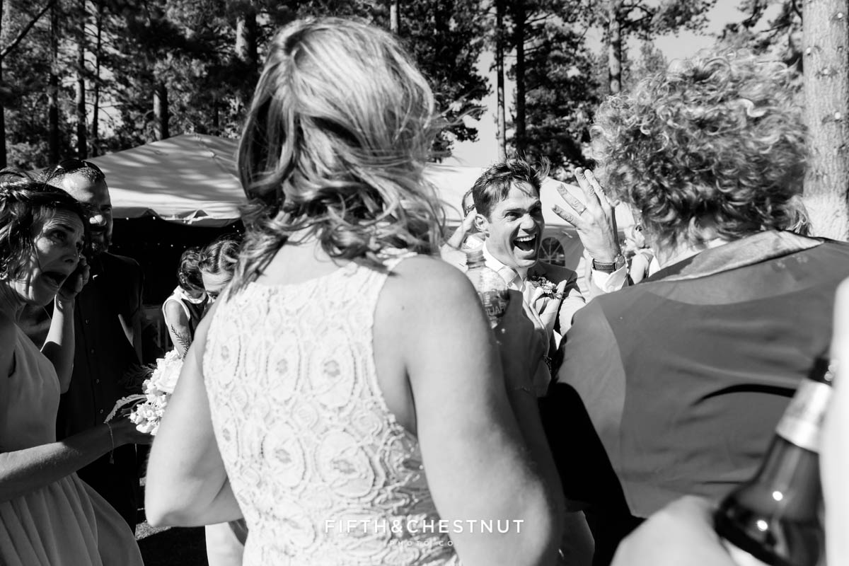 groom shows off his ring to guests at a lake tahoe wedding