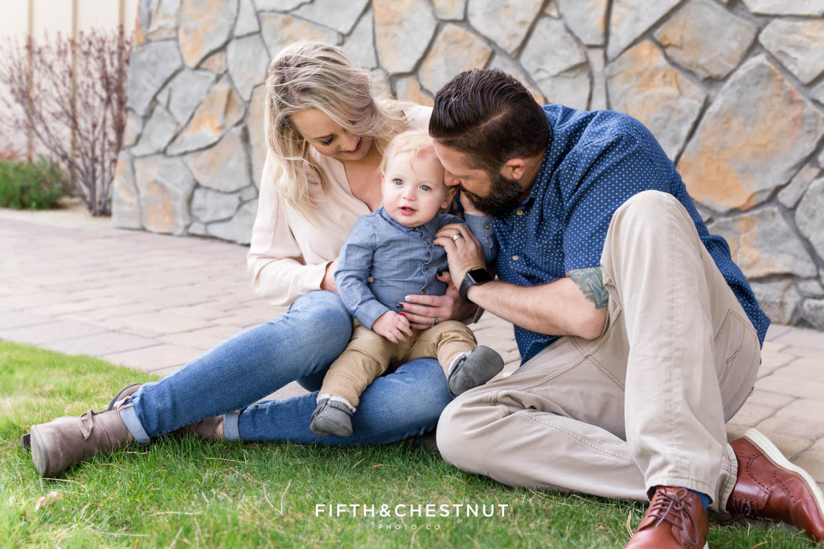 Family snuggling together for Golf Themed One Year Photos by Reno Baby Photographer