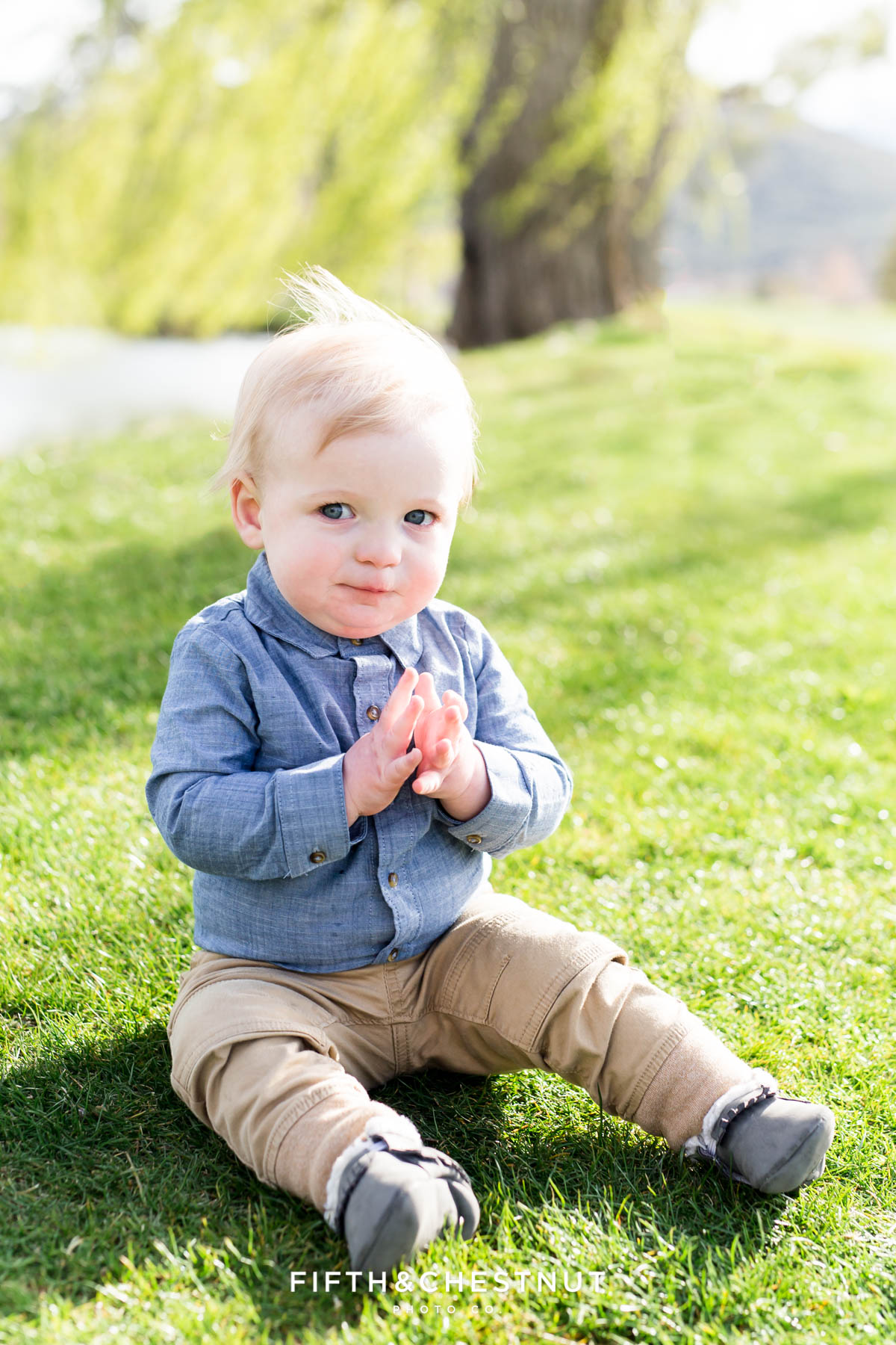 Baby boy looking mischievously at photographer for his Golf Themed One Year Photos by Reno Baby Photographer