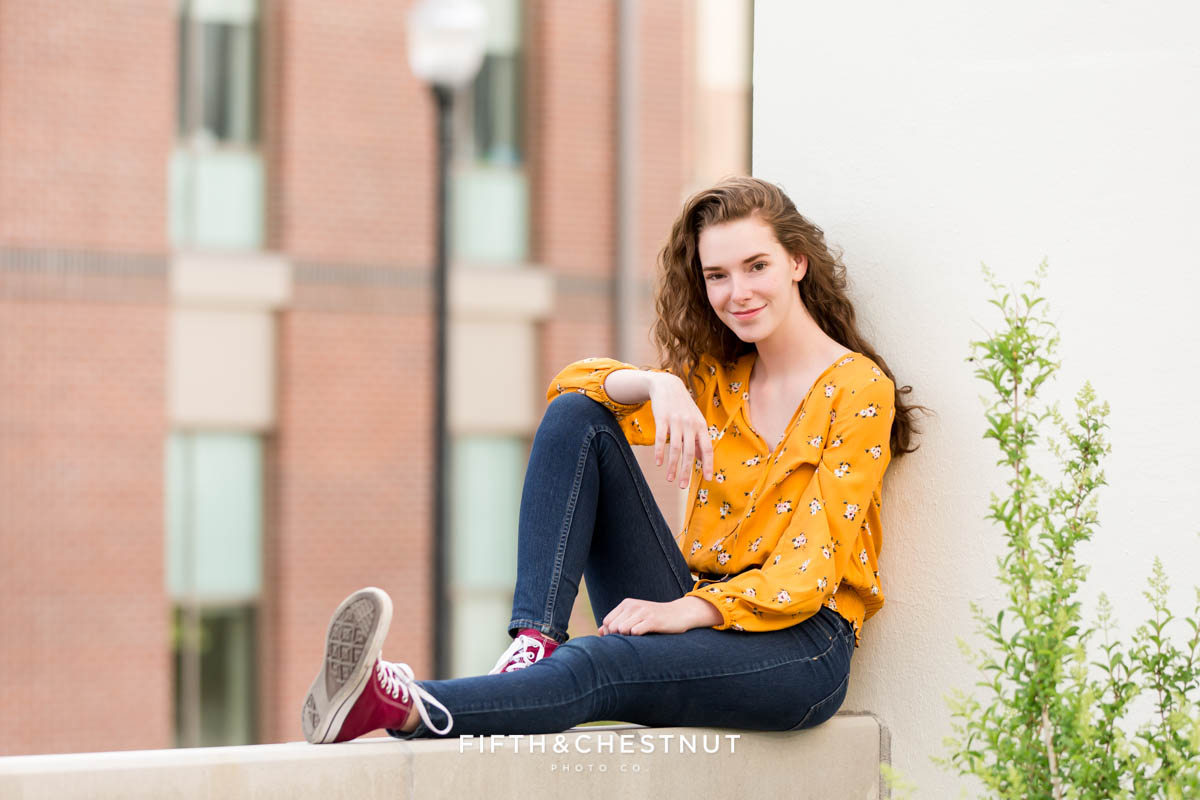 Fun and edgy spring Reno High School Portraits by Reno HIgh School Senior Photographer at UNR on a windy spring day.
