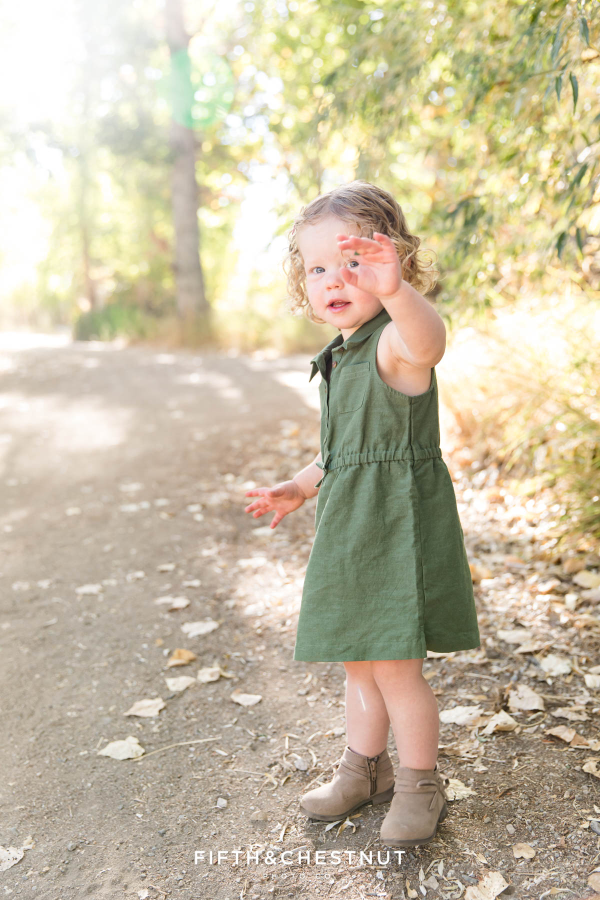 Toddler plays on path