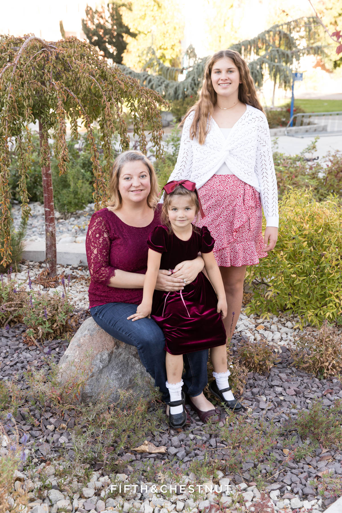 A mother sits with her daughters for colorful family portraits at UNR