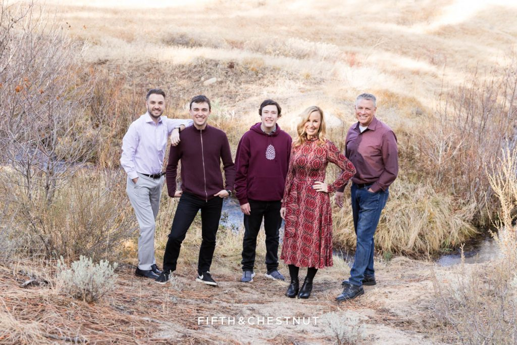 A spunky family pose for tahoe portraits in the fall
