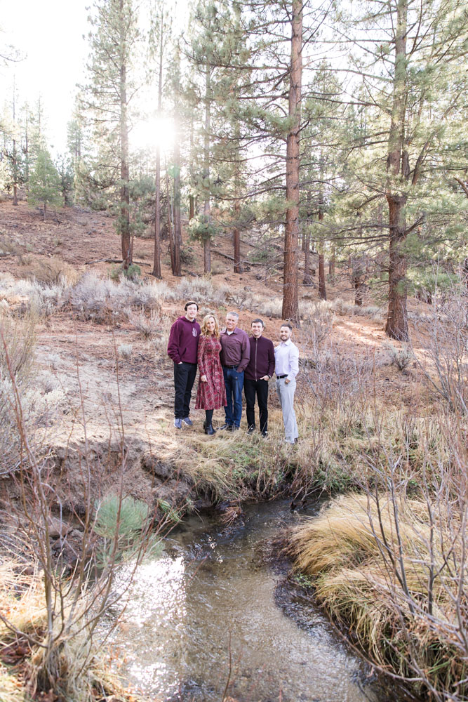 Family wearing burgundy tones in a meadow above a babbling brook for Carson City Family Portraits in the Fall