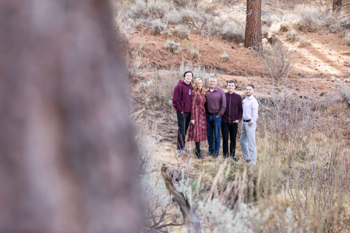 Family wearing burgundy tones in a meadow for Carson City Family Portraits in the Fall