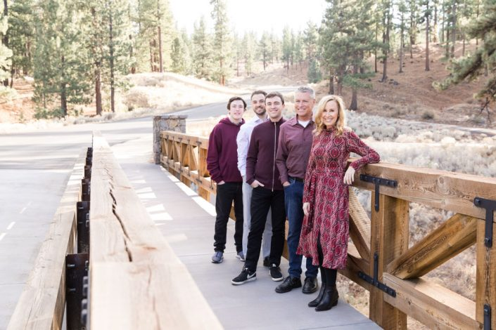 Family wearing burgundy tones on a bridge for Carson City Family Portraits in the Fall