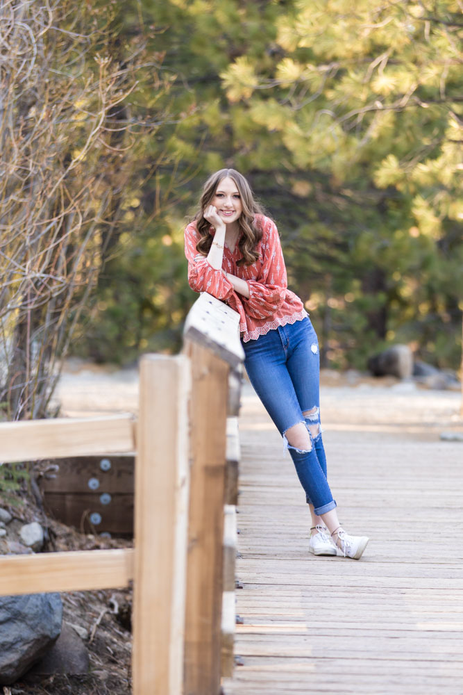 a high school senior girl stands on a bridge for her photos by Reno High School Senior Photographer Fifth and Chestnut